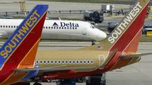 Southwest Airlines' culture focuses on offering value and injecting fun into its service, and that works with its budget-conscious customers. (George Widman/Associated Press)