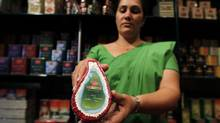 An employee shows locally-produced Sri Lankan tea at a shop in Colombo January 23, 2013. The world's six largest tea-growing nations have formed an international organization to promote and develop the commodity and ensure its production is sustainable. (DINUKA LIYANAWATTE/REUTERS)