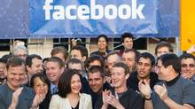 In this image provided by Facebook, Facebook founder, Chairman and CEO Mark Zuckerberg, center, applauds at the opening bell of the Nasdaq stock market, Friday, May 18, 2012, from Facebook headquarters in Menlo Park, Calif. (Zef Nikolla/Zef Nikolla/Facebook/AP)