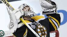 Boston Bruins Tim Thomas celebrates (Peter Power/The Globe and Mail)