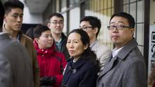 Former New Coast Realty agents Wendy Yang, second right, stands with other former employees after being asked to leave New Coast's realty office on March 9, 2016. (Ben Nelms/The Globe and Mail)