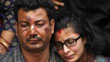 Nepalese residents mourn the death of a relative following an earthquake, at a mass cremation in Kathmandu on April 26, 2015. Aid groups and governments worldwide intensified efforts April 26 to help earthquake-hit Nepal, but blocked roads, downed power lines and overcrowded hospitals posed formidable challenges in an already poor country. (PRAKASH MATHEMA/AFP/Getty Images)