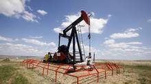 A Canadian Natural Resources pump jack pumps oil out of the ground near Dorothy, Alberta. (© Todd Korol / Reuters/REUTERS)
