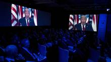 Video screens display images of US President-Elect Donald Trump during the Halifax International Security Forum in Halifax on Friday, November 18, 2016. (Darren Calabrese/THE CANADIAN PRESS)