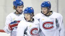 Montreal Canadiens Ryan White, Brendan Gallagher, and Alex Galchenyuk, left to right, take a breather during their training camp Tuesday, January 15, 2013 in Brossard, Que. (Paul Chiasson/THE CANADIAN PRESS)