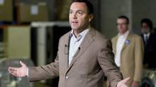 PC Leader Tim Hudak speaks to journalists at a media availability in a warehouse in Etobicoke, Ontario during his election campaign for the Ontario Premiership on Monday September 19, 2011. (THE CANADIAN PRESS / Chris Young/THE CANADIAN PRESS / Chris Young)