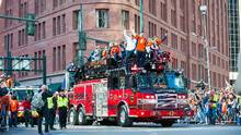 Bronco players celebrated Super Bowl in parade through Denver on Tuesday. (Dustin Bradford/Getty Images)