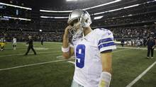 Dallas Cowboys quarterback Tony Romo walks off the field after the 37-36 loss to the Green Bay Packers after an NFL football game Sunday, Dec. 15, 2013, in Arlington, Texas. (Tim Sharp/AP)
