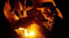 Living in caves outside Moab, Utah, Daniel Suelo lives off of foraged plants, road kill and dumpster contents. He refuses to accept or spend currency. (Hyoung Chang/ASSOCIATED PRESS)
