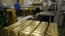File photo of gold bars on a table awaiting transport at a plant of gold refiner and bar manufacturer Argor-Heraeus SA in the southern Swiss town of Mendrisio. (ARND WIEGMANN/REUTERS)
