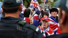 Loyalist demonstrators take part in a protest against the upcoming G8 summit, to be held near Enniskillen, in Belfast, on June 15, 2013. Leaders of the G8 countries will meet at Lough Erne in Northern Ireland for the G8 Summit on June 17 and 18. (YVES HERMAN/REUTERS)