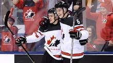 Canada forward Matt Barzal (14), left, celebrates his goal against Latvia with teammate Philippe Myers (6) during first period IIHF World Junior Championship hockey action in Toronto on Thursday, December 29, 2016. (Nathan Denette/THE CANADIAN PRESS)