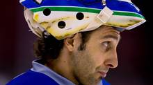 Vancouver Canucks' goalie Roberto Luongo looks on during practice in Vancouver, B.C., on Monday April 25, 2011. Vancouver and the Chicago Blackhawks play game 7 of a Western Conference quarterfinal Stanley Cup playoff series Tuesday. Canucks' coach Alain Vigneault said Monday that Luongo would start in game 7. THE CANADIAN PRESS/Darryl Dyck (Darryl Dyck/CP)