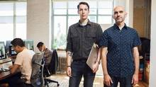 Justin Bull, left, and Lee Brotherston work at Wealthsimple, keeping a watchful eye on possible security breaches. (JENNIFER ROBERTS/The Globe and Mail)