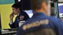 Traders work on the floor of the New York Stock Exchange, July 23, 2012. (Brendan McDermid/Reuters)