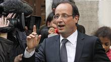 President-elect Francois Hollande gestures as he leaves his campaign headquarters in Paris on May 7, 2012. (Remy de la Mauviniere/Remy de la Mauviniere/Associated Press)