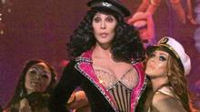 "Cher (centre) in a scene from ""Burlesque"""