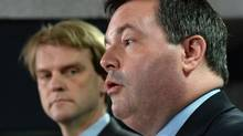 Employment Minister Jason Kenney speaks at a news conference in Ottawa on Friday, June 20, 2014 on reforms to the Temporary Foreign Worker Program. Citizenship and Immigration Minister Chris Alexander is seen in background. (Sean Kilpatrick/THE CANADIAN PRESS)