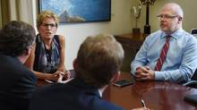Andrew Bevan, right, Premier Kathleen Wynne's Chief of Staff is pictured during a photo op with Toronto Mayor John Tory at the Ontario legislature on Sept. 7, 2016. (Fred Lum/The Globe and Mail)