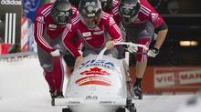 Canada's Lyndon Rush (C), Jesse Lumsden (R), Cody Sorenson (L) and Neville Wright push off the start line during Men's World Cup Bobsleigh in Whistler, British Columbia February 4, 2012. The team placed third in the race. (ANDY CLARK/REUTERS)