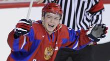 Russia's Yevgeni Kuznetsov celebrates a goal against Latvia during the third period of play. (STRINGER/CANADA/Reuters)