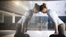 sad businesswoman (diego cervo/Getty Images/iStockphoto)