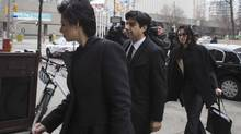 Former CBC radio host Jian Ghomeshi arrives at a Toronto court with his legal team for day five of his trial on Feb. 8. (Chris Young/THE CANADIAN PRESS)