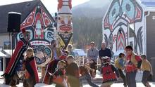 Prince William and his wife Kate, the Duke and Duchess of Cambridge, watch native youth dancers perform during a welcoming ceremony in Carcross, Yukon, Wednesday, Sept. 28, 2016. (Jonathan Hayward/THE CANADIAN PRESS)