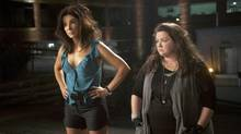 Sandra Bullock, left, and Melissa McCarthy play mismatched cops chasing a drug dealer in South Boston. (Associated Press/20th Century Fox)