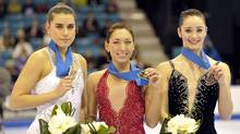 Silver medalist Cynthia Phaneuf (L), gold medalist Amelie Lacoste and bronze medalist Kaetlyn Osmond (R) pose with their medals at the Canadian Figure Skating Championships in Moncton, New Brunswick, January 21, 2012. (MIKE CASSESE)