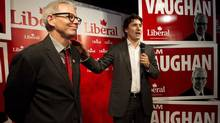 Federal Liberal leader Justin Trudeau, right, speaks to supporters with candidate for the Trinity-Spadina riding Adam Vaughan, left, during a campaign stop in Toronto on May 22. (Nathan Denette/THE CANADIAN PRESS)