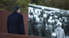 A man visits Coal Harbour's Komagata Maru monument in Vancouver, Thursday, January 16, 2014. The Vancouver police will not be laying charges against a man photographed allegedly urinating on the monument. (Rafal Gerszak for the globe and mail)