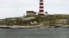 The Sambro Island lighthouse, the oldest operating lighthouse in North America, is seen on Saturday, May 18, 2013. Sambro, like 970 other lighthouses across Canada, has been declared surplus by the federal Fisheries Department. (Andrew Vaughan/THE CANADIAN PRESS)