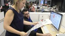 Employees at La Presse work on the final weekday edition of the newspaper on December 30, 2015. (Bernard Brault/La Presse)