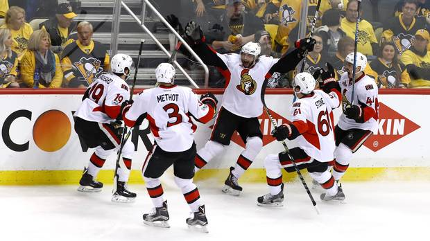 The Ottawa Senators celebrate Bobby Ryan's overtime winner in Game 1 of their third-round series against the Penguins in Pittsburgh Saturday.