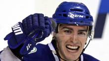 Vancouver Canucks' Alex Burrows celebrates after scoring during NHL hockey action in Vancouver in this January 7, 2010 file photo. Undrafted out of junior and left to ride the bus in the hinterlands of the ECHL, Alex Burrows has emerged as an integral piece of what might be the best line in hockey. THE CANADIAN PRESS/Darryl Dyck (DARRYL DYCK)