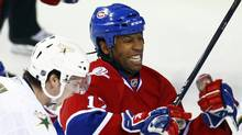 Georges Laraque, right, in a January, 2010, file photo. (Shaun Best/Reuters)