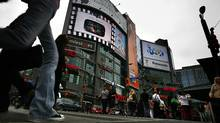 Under a proposed bylaw, Toronto would charge a per-sign levy for billboards such as these at Yonge-Dundas Square. (Fernando Morales/The Globe and Mail)
