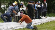 Volunteers help sandbag in St. Francois Xavier, Man., on July 8, 2014. Forecasters say the latest data shows southern Manitoba remains at moderate to major risk of spring flooding. (JOHN WOODS/THE CANADIAN PRESS)