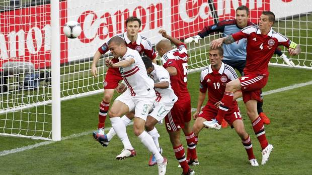 Portugal's Pepe scores a goal against Denmark during their Euro 2012 Group B soccer match at the new stadium in Lviv, June 13, 2012. (GLEB GARANICH/REUTERS)