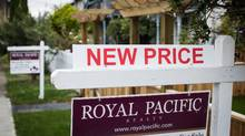 A real estate for sale sign is pictured in front of a home in Vancouver, British Columbia on Oct. 4, 2016. (Ben Nelms/The Globe and Mail)