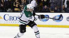 Dallas Stars center Tyler Seguin shoots and scores during the shootout of an NHL hockey game against the Boston Bruins in Boston on Tuesday, Nov. 5, 2013. The Stars won 3-2. (ELISE AMENDOLA/THE ASSOCIATED PRESS)