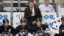 Mike Johnston, centre, led the Pittsburgh Penguins to a 58-37-15 record in less than two years with the team. (Gene Puskar/AP Photo)