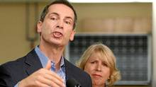 Ontario Premier Dalton McGuinty speaks to the media in front of Health Minister Deb Matthews at the University of Western Ontario in London, Ontario, Thursday, Sept. 8, 2011. (DAVE CHIDLEY/DAVE CHIDLEY/THE CANADIAN PRESS)