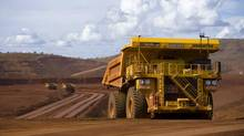 FEB. 14: RIO TINTO. The miner is expected to report a 49-per-cent plunge in second-half profit to $3.93-billion (U.S.); analysts also expect more details on Rio's stated goal of $5-billion in cost cuts by the end of 2014. In photo: Remotely controlled tipper trucks operate at a Rio Tinto iron ore mine in Western Australia. (HANDOUT/REUTERS)