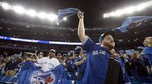 Fans cheer during player introductions before the American League wild-card game between the Baltimore Orioles and the Toronto Blue Jays in Toronto, Tuesday, Oct.4, 2016. (Mark Blinch/THE CANADIAN PRESS)
