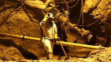 Miners at Gold Fields's highly mechanized South Deep operation (SIPHIWE SIBEKO/REUTERS)