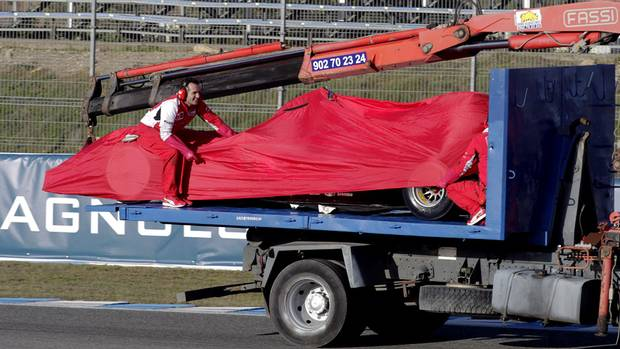Ferrari Formula One racing team members look after the new F14 T, as it's pulled by a crane at the Circuito de Jerez on Tuesday, Jan. 28, 2014, in Jerez de la Frontera, Spain. (Miguel Angel Morenatti/AP Photo)