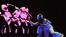 "Ninjas fight evil pink robots in McAnuff's musical about cancer. <137>as ""Karate Girl"" with robots in La Jolla Playhouse's world-premiere production of YOSHIMI BATTLES THE PINK ROBOTS, story by Wayne Coyne and Des McAnuff, music and lyrics by The Flaming Lips, directed by Des McAnuff, playing in the Mandell Weiss Theatre November 6 - December 16; photo by <137> (Kevin Berne)"