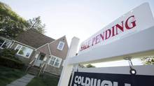 In this April 26, 2012, file photo, a sign advertises a pending residential real estate sale in Framingham, Mass. (Bill Sikes/AP)